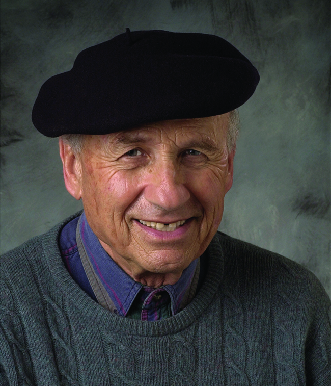 A photograph of Walter Kohn is shown.
