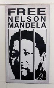 """words """"free Nelson Mandela"""" above graphic image of Mandela behind bars"""